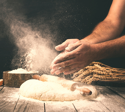 A baker kneading dough. ProPrint manufacture labels and packaging for the bakery sector quickly and reliably.